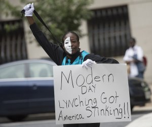 Protesters vent their frustration as Officer Caesar Goodson found not guilty