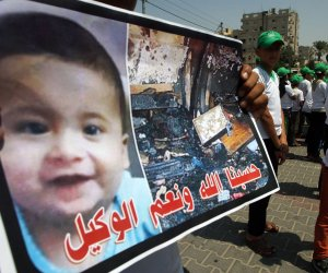 Palestinians protest the burning of a child in the West Bank