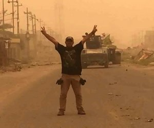 Iraqi government forces battle ISIS militants in bid to retake Fallujah