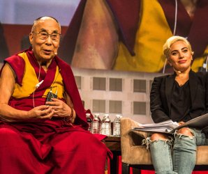 Dalai Lama and Lady Gaga share the stage at the United States Conference of Mayors