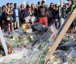 People pay their respects in the aftermath of the attack in Nice, France