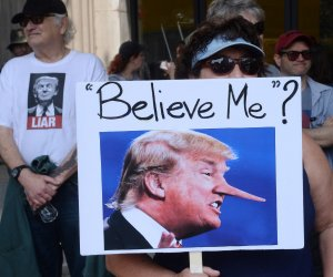 Demonstrators protest President Trump at March for Truth in Los Angeles