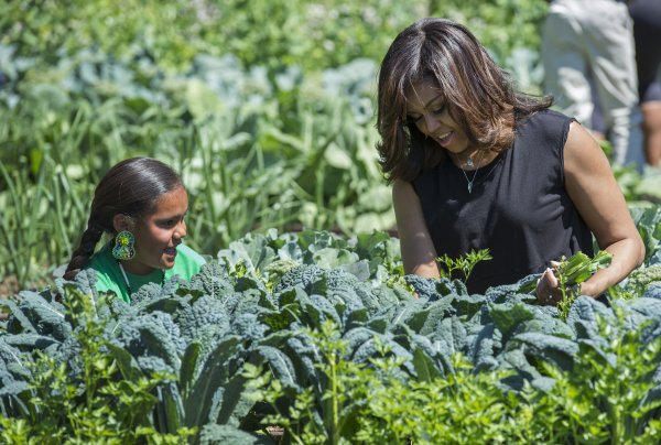 Michelle Obama Harvests Vegetables From The White House Garden