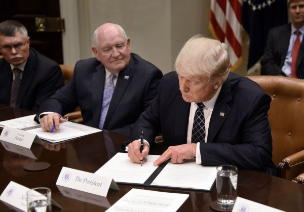 President Trump signs the Executive Order Promoting Agriculture