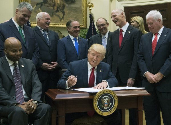 President Trump signs the Veterans Choice Program Extension and Improvement Act in Washington