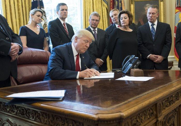 President Trump signs a memorandum regarding the Steel Industry at the White House