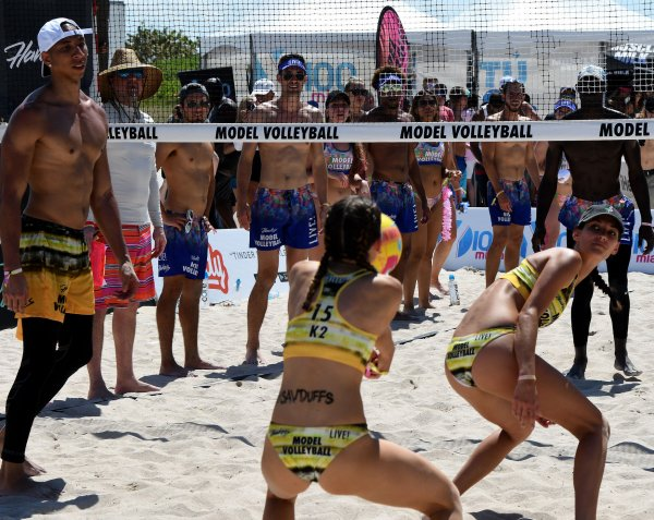 Models take part in a beach volleyball tournament in miami for Modeling agencies in miami