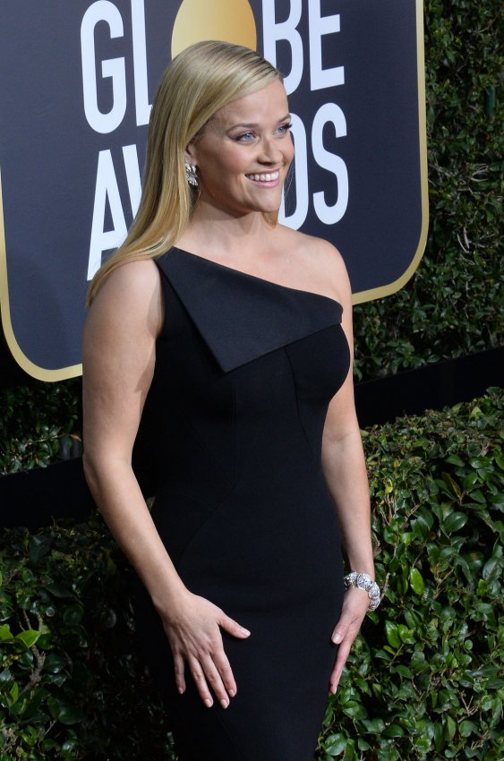 stars wear black on the red carpet at the golden globes