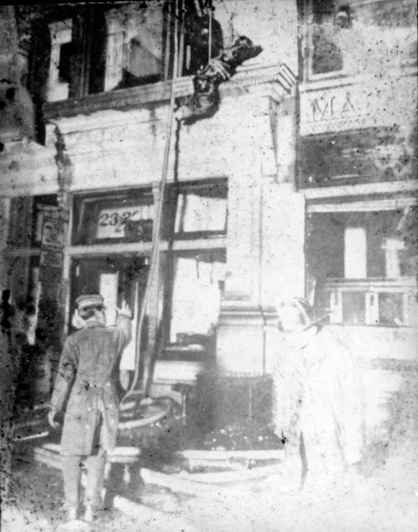 a view on the triangle shirtwaist fire Firemen work at the scene of the triangle shirtwaist company fire in the asch building on new york's washington place, in this march 25, 1911, photo.