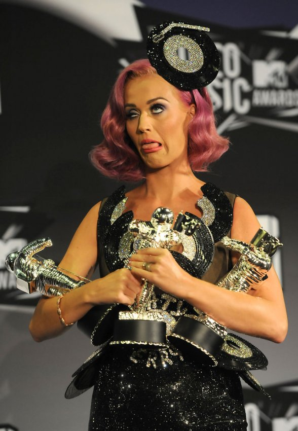 Katy Perry appears backstage with the awards she garnered at the MTV Video Music Awards in Los Angeles
