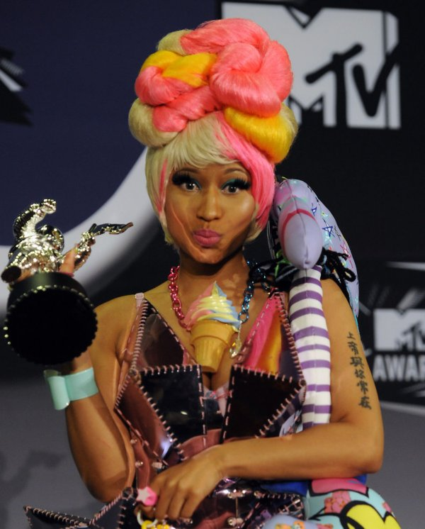 Nicki Minaj appears backstage with the award she garnered at the MTV Video Music Awards in Los Angeles