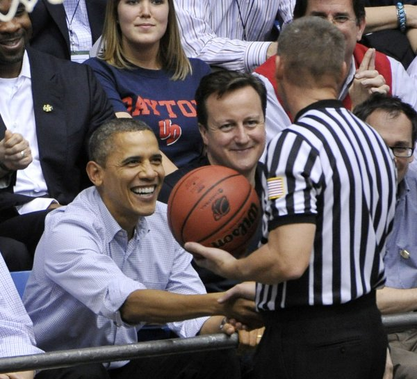 Obama Shakes Hands with Referee at NCAA Tournament in Dayton, Ohio