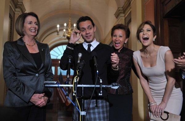 Singers Jennifer Lopez and Marc Anthony speak to the media on Capitol Hill in Washington