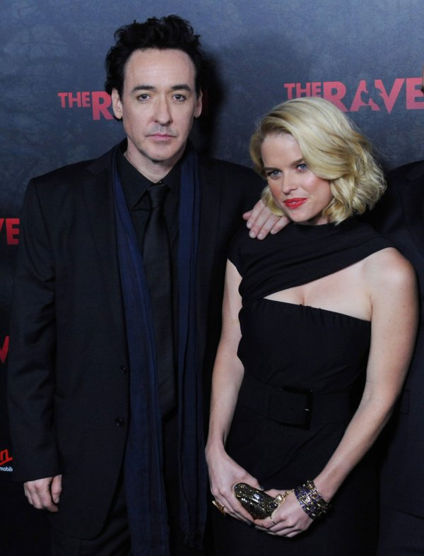 "John Cusack and Alice Eve attend ""The Raven"" premiere in Los Angeles"