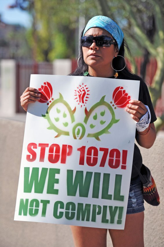 Woman protests SB1070 in Arizona