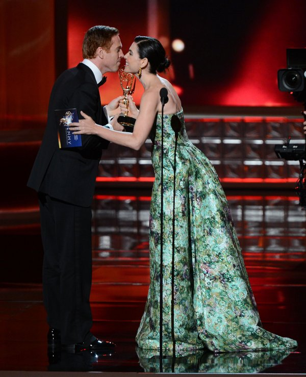 Julianna Margulies and Damian Lewis attend the 64th Primetime Emmy Awards in Los Angeles