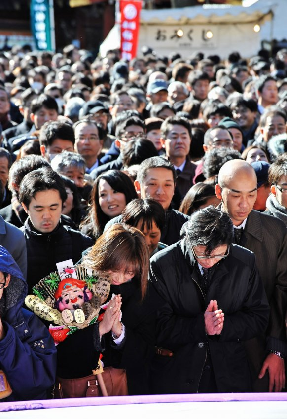 Japanese office workers pray on the first business day