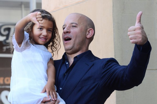 VIn Diesel holds his daughter Similche