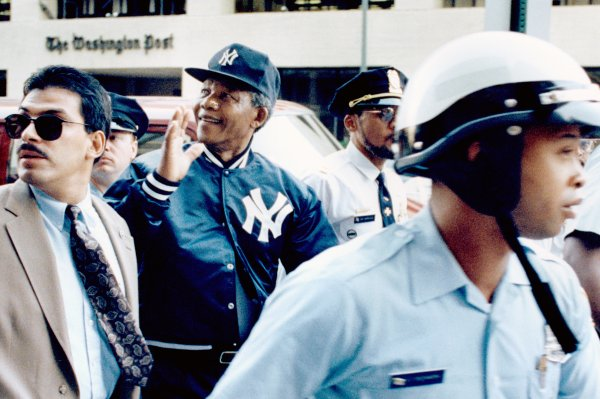 Nelson Mandela Strolling in Yankees Cap and Jacket