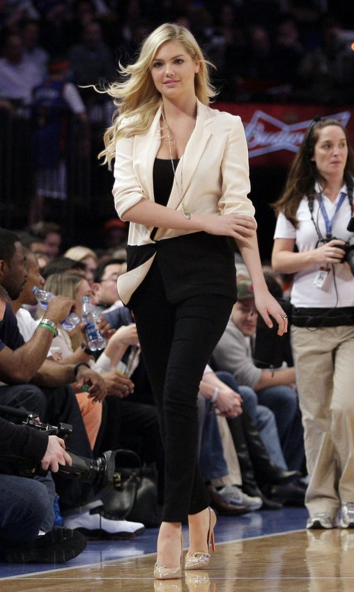Kate Upton walks on the court during a time out as the New York Knicks play the Orlando Magic at Madison Square Garden in New York