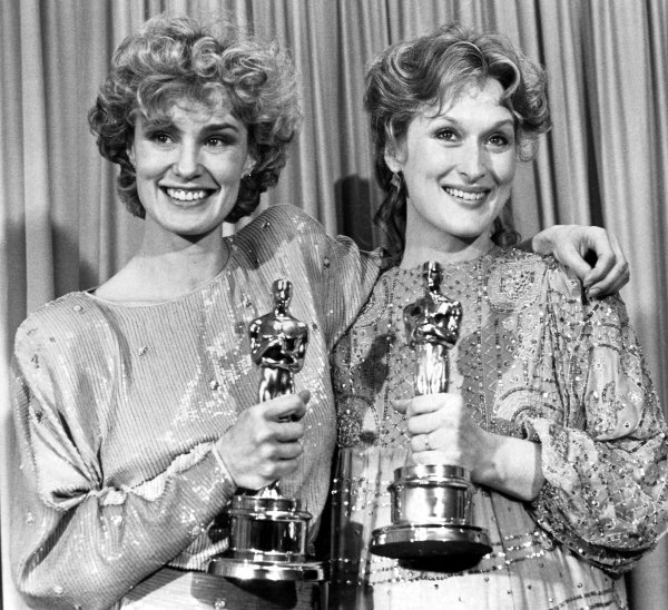 Jessica Lange and Meryl Streep showing off their Oscar statuettes.