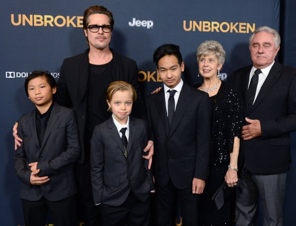 Brad Pitt with children Pax, Shiloh, and Maddox