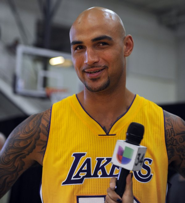 Los Angeles Lakers Robert Sacre gives an interview at Lakers Media Day in El Segundo on September 29, 2014. UPI/Lori Shepler - Los-Angeles-Lakers-media-day_5_1