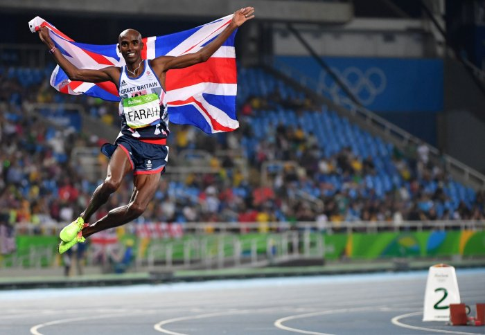 0874e44b7d8 Mohamed Farah of Great Britain leaps in the air after winning the gold  medal in the Men s 5000 meter Final at Olympic Stadium at the 2016 Rio  Summer ...