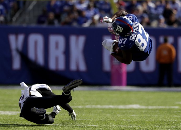 New York Giants Sterling Shepard get launched in the air when tackled by  Baltimore Ravens Shareece Wright in the second half in week 6 of the NFL at  MetLife ... a874ab90d