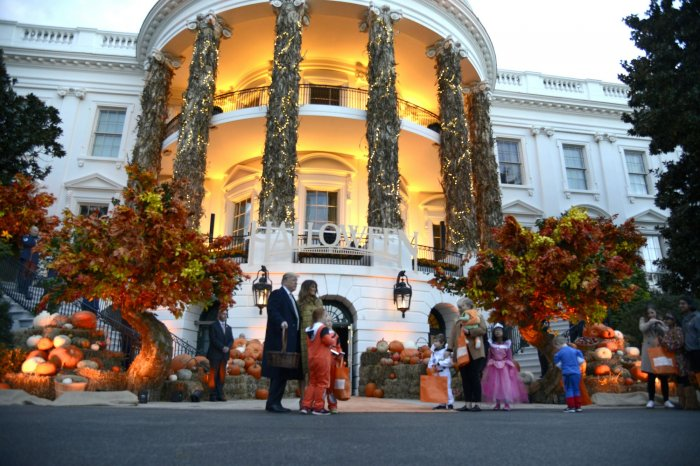 President Donald Trump And First Lady Melania Trump Welcome Trick Or Treaters To The White House For Halloween Festivities On Sunday In Washington D C