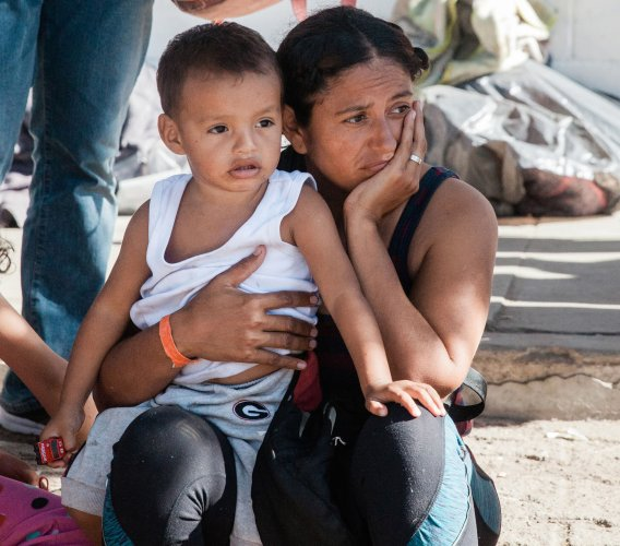 Migrants wait to apply for U.S. asylum at border