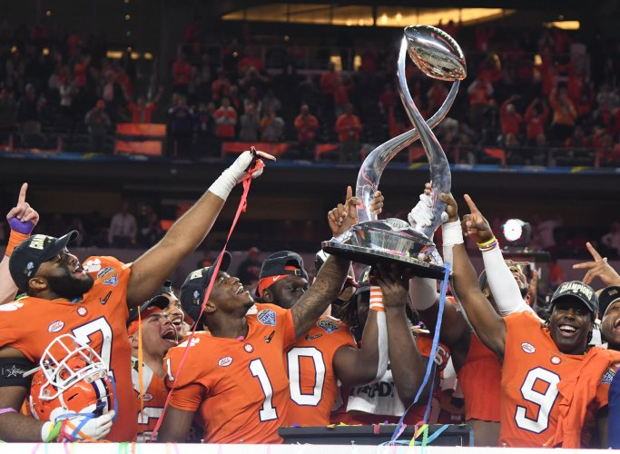 Clemson players celebrate afetr beating Notre Dame 30-3