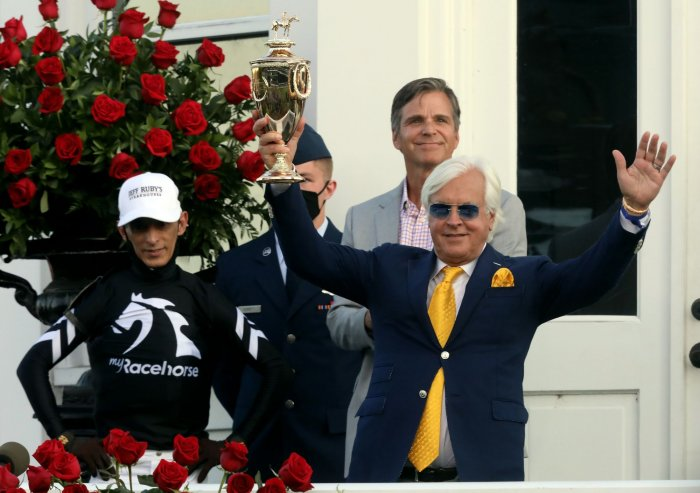 Trainer Bob Baffert celebrates with Jockey John Velazquez Win Kentucky Derby
