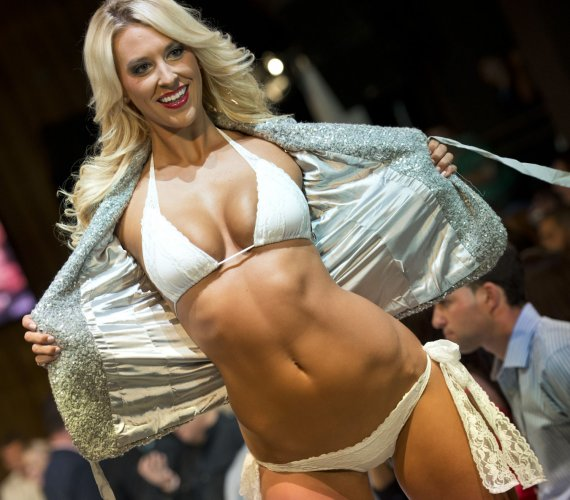 08f27ee78 A Miami Dolphin cheerleader presents a swimsuit creation by Lila Nikole  designer during the Miami Dolphins Cheerleaders 2014 Swimsuit Calendar  Unveiling at ...