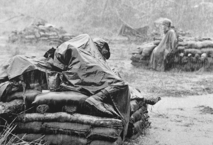 An American Soldier With The First Army Division Sleeps Atop A Pillbox Bunker During Monsoon Downpour Following Heavy Vietcong Sniper And Mortar Fire Near
