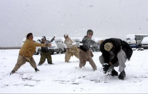Pakistani children and adults have a snow ball fight in Charman, Pakistan