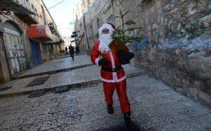 Palestinian Plays Santa Claus In Jerusalem