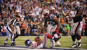 The Giants Bradshaw Scores the Game-Winning Touchdown Against the Patriots during Super Bowl XLVI in Indianapolis