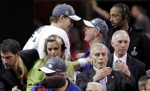 MVP Manning Talks with Giants Head Coach Coughlin After Super Bowl XLVI win in Indianapolis