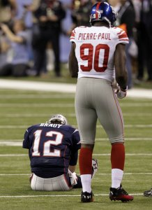 Giants Pierre-Paul Stands Over a Fallen Patriots During Super Bowl XLVI in Indianapolis
