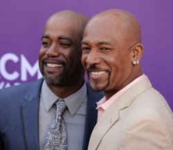 Musician Darius Rucker and talk show host Montel Williams arrive at the Academy of Country Music Awards in Las Vegas