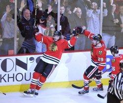 Blackhawks Frolik and Bickell celebrate goal in Chicago