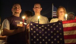 Candle Light Vigil Expresses Sorrow, Defians