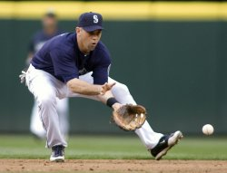 Seattle Mariners' shortstop Jack Wilson fields a hit by New York Yankees' Derek Jeter in Seattle.