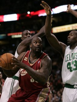 Cavaliers O'Neal drives to net against Celtics in Boston, MA.