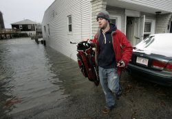 John Sweeney evacuates his apartment during a Blizzard in Scituate, Massachusetts.