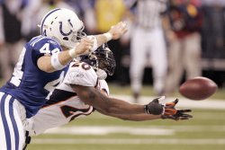 Broncos' Dawkins Intercepts Pass Intended for Colts Clark
