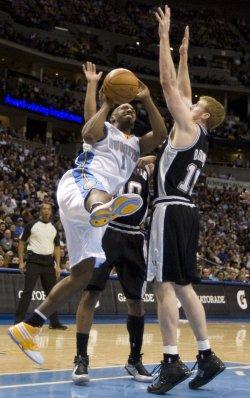 Nuggets Billups Drives Against Spurs Bonner in Denver
