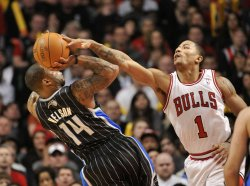 Magic's Nelson Shoots as Bulls' Rose Defends in Chicago