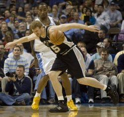Nuggets Smith Tips Ball Away From Spurs Bonner in Denver